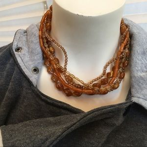 Brown beaded necklace.
